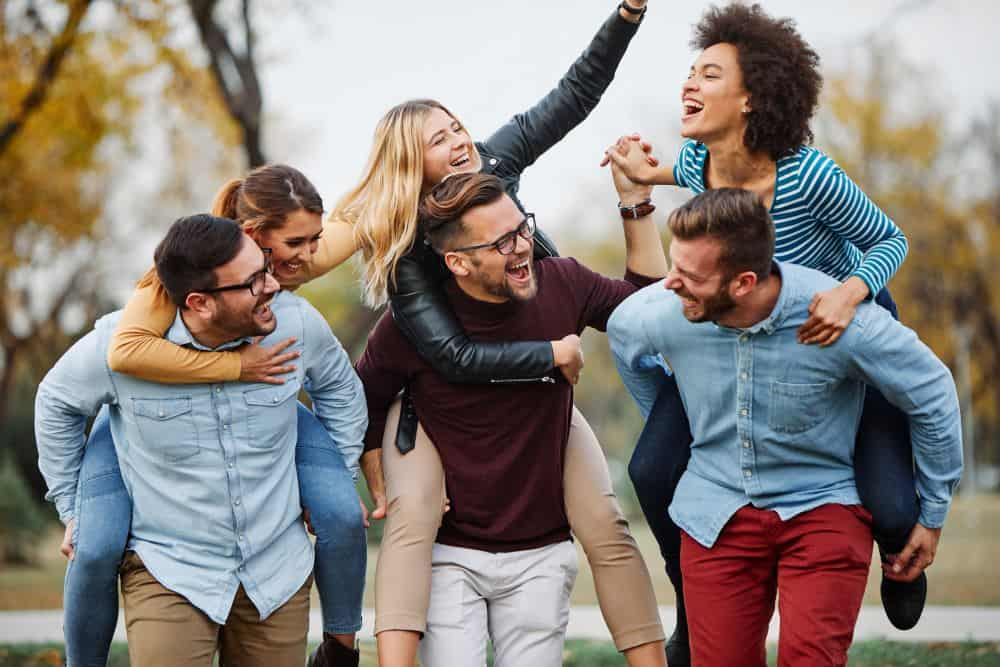 Happy Patient enjoying Friends after Addiction Recovery