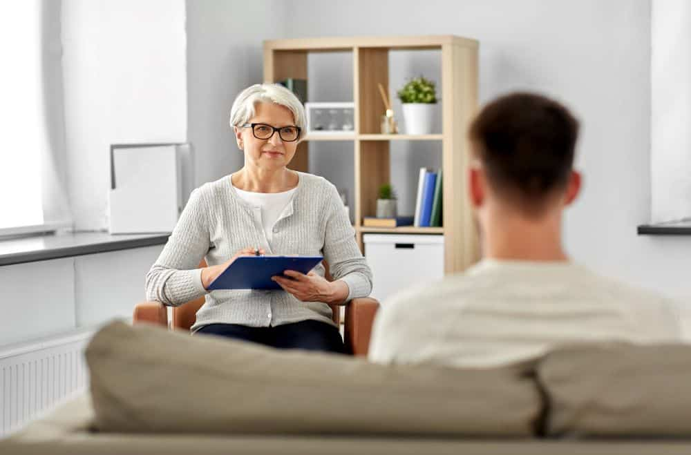 Male Patient in Mental Health Treatment Session with female Therapist